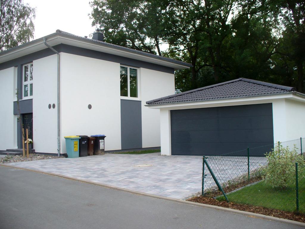 Garagen passend zum haus carport scherzer for Stadtvilla flachdach